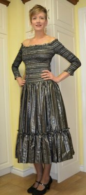 a woman wearing silver dress. small online business support