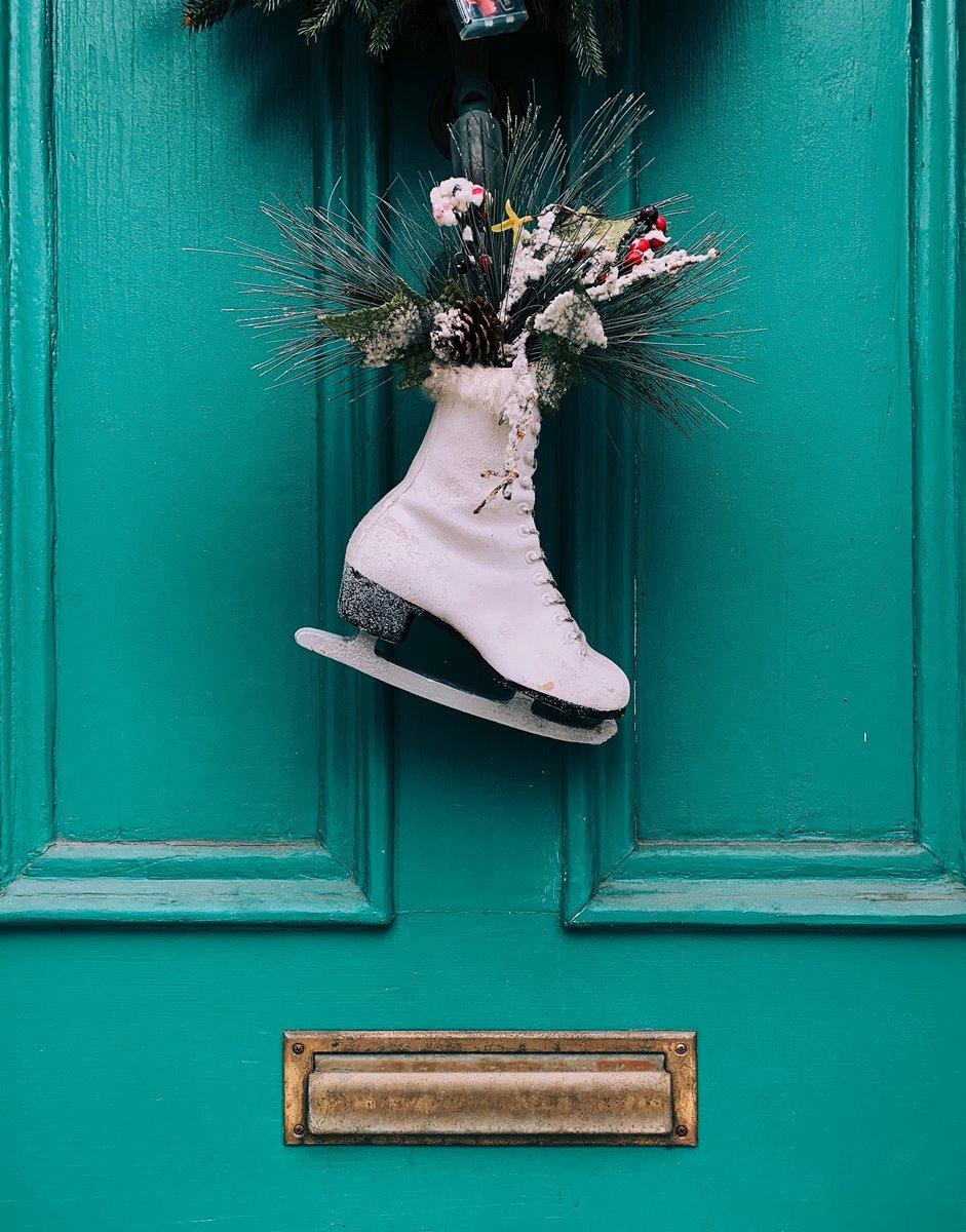 white ice skate show hang on door near to postal box