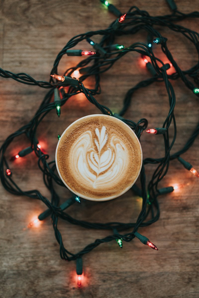 latte art surrounded by Christmas light