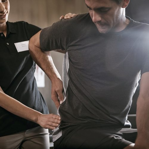 Cove Sport Physiotherapy vStore Main Image Man with back pain getting treatment