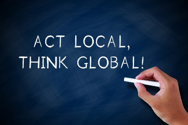 Act Local Think Global sign. vlife blog on strengthening local economies during COVID-19