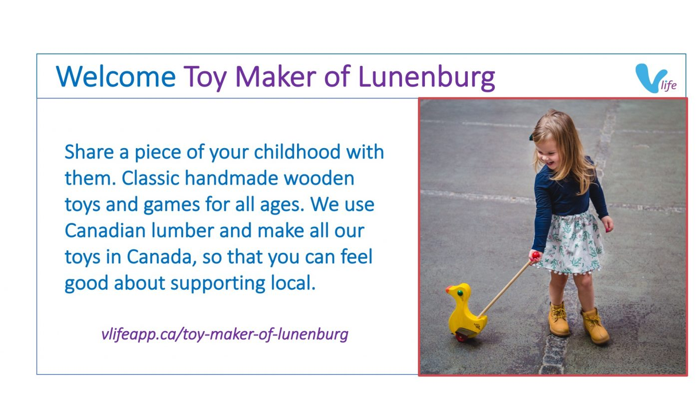 vLife Welcome Toy Maker of Lunenburg Girl playing with wooden push duck toy